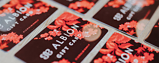 Red Albion gift cards arranged on a table